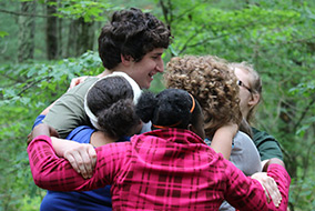 Campers Hugging