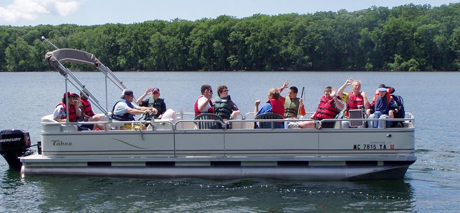 Pontoon Boat on Blue Lake