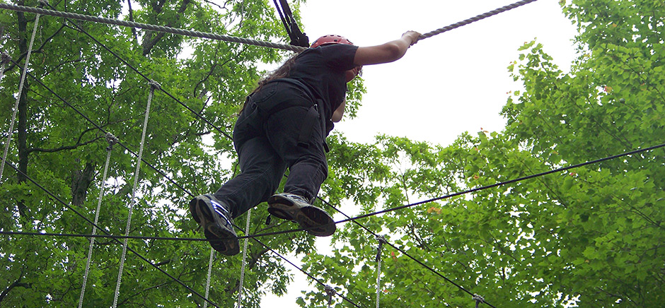 Young Woman on Ropes Course